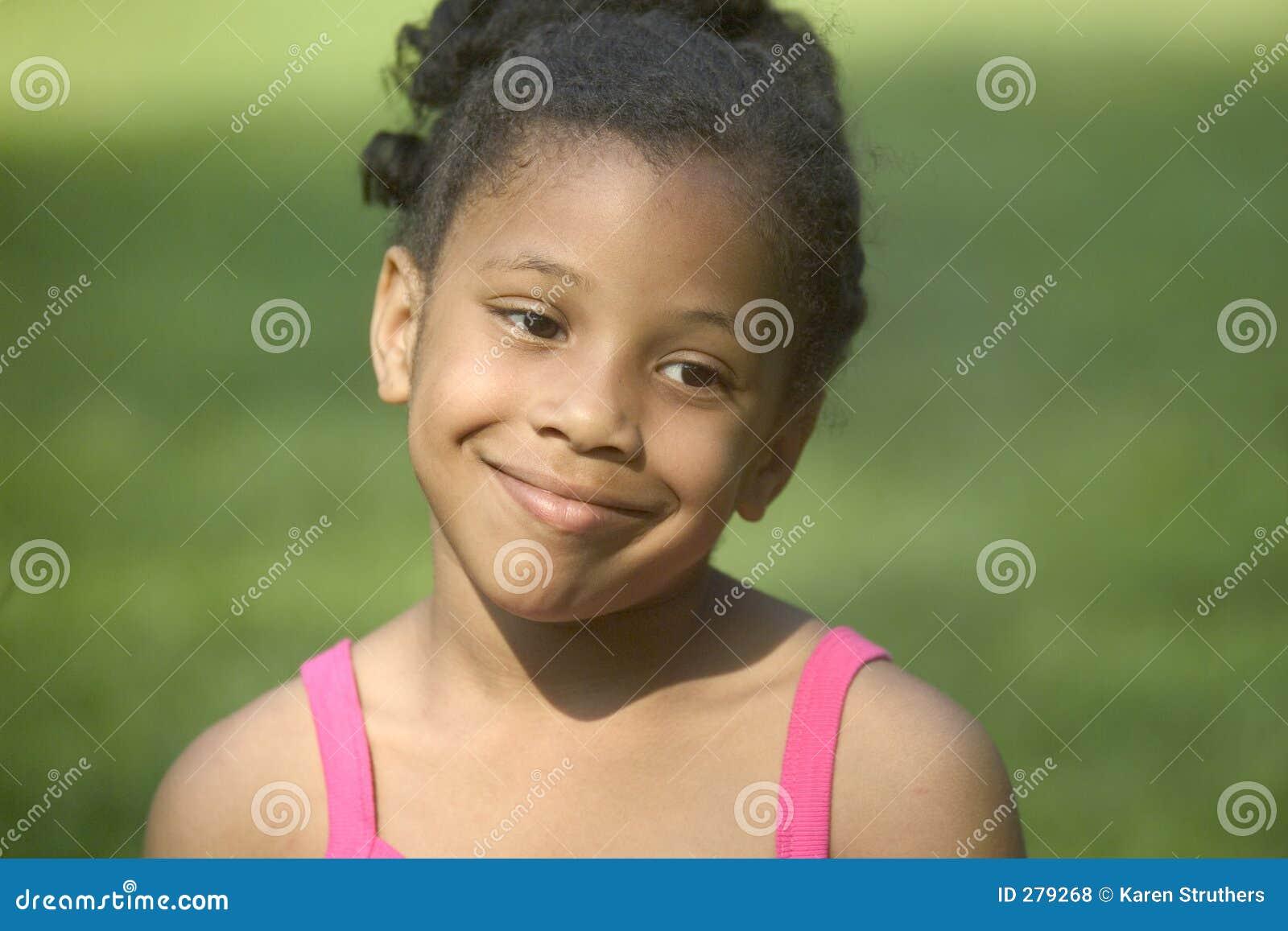Het mooie meisje glimlachen