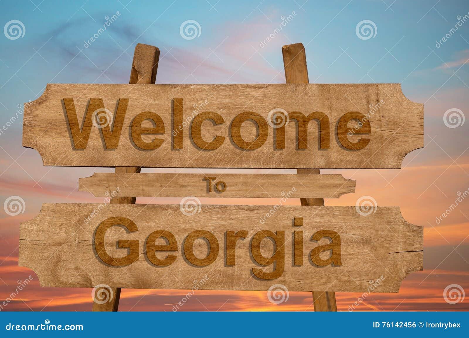 Het onthaal aan Georgië zingt op houten achtergrond