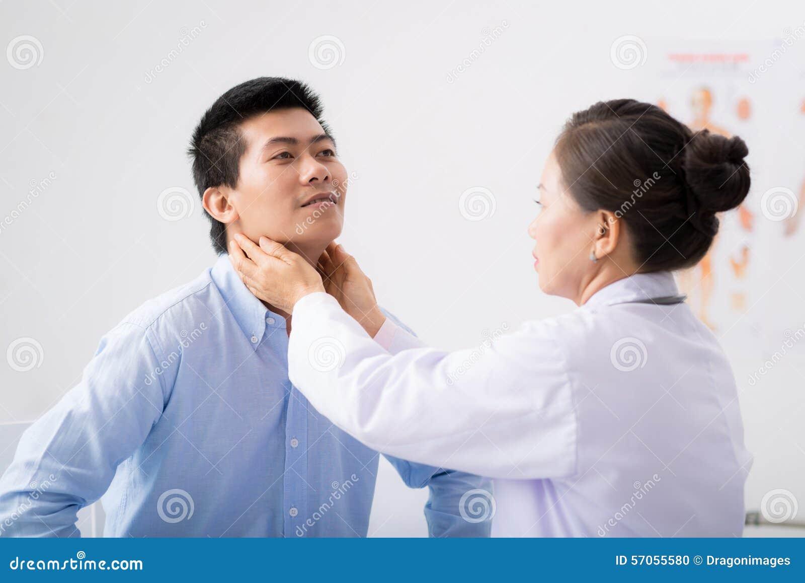 Het palperen van lymfeknoop