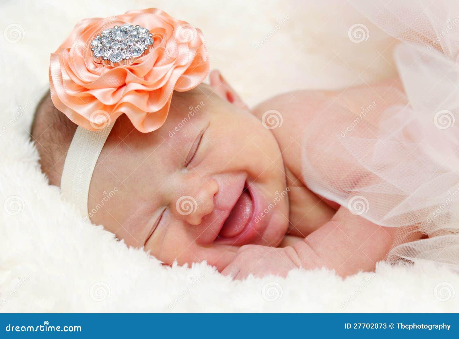 Het pasgeboren baby lachen
