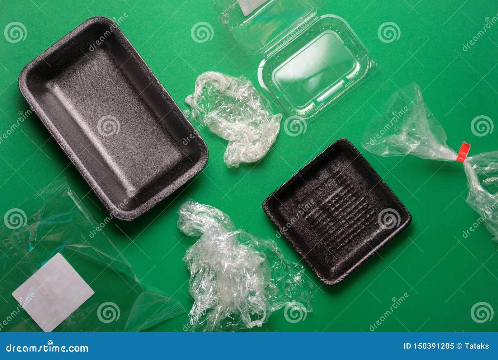 Het plastiek gebruikte beschikbaar voedselpakket