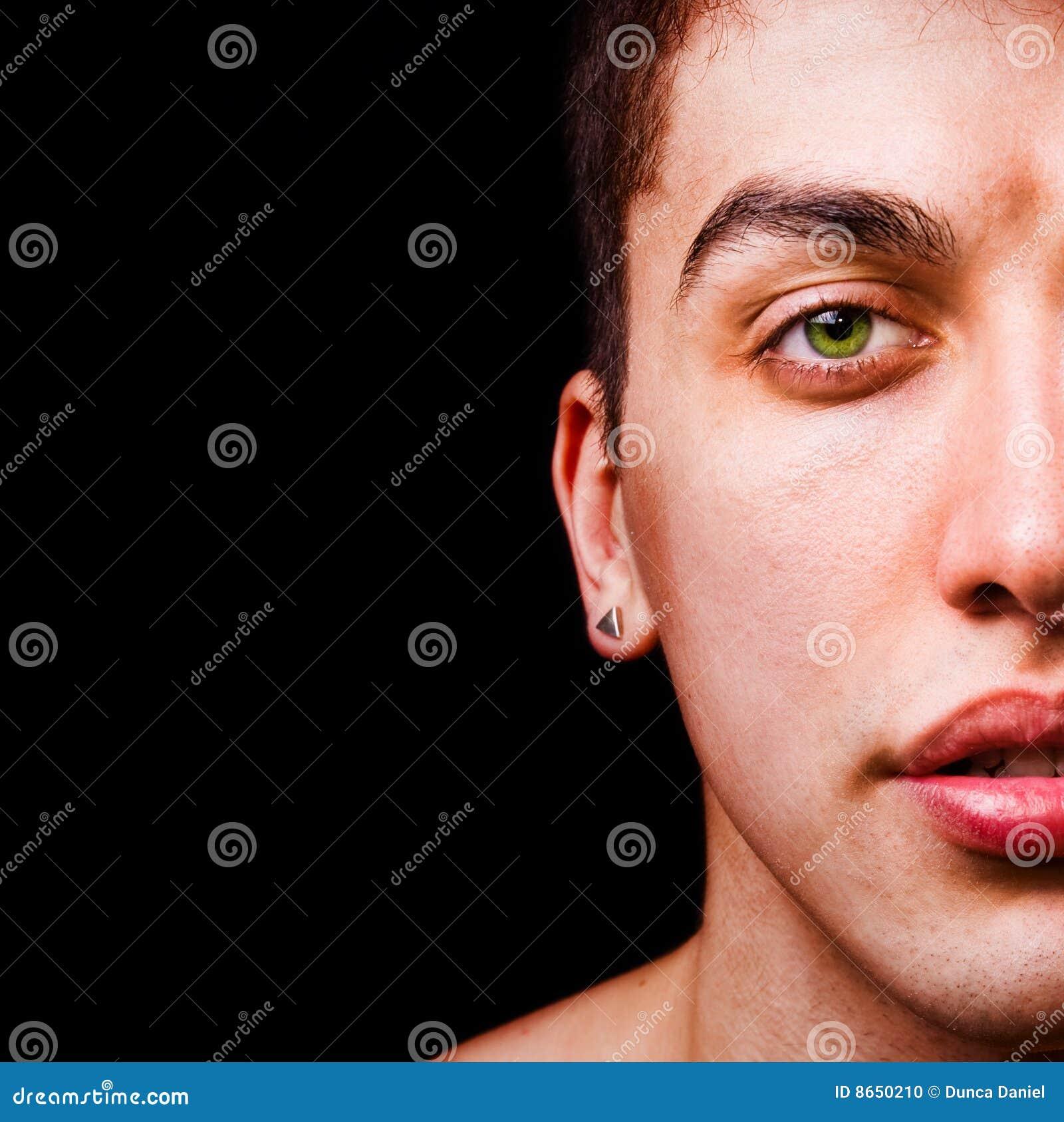 Het portret van de close-up - half gezicht van de mannelijke mens