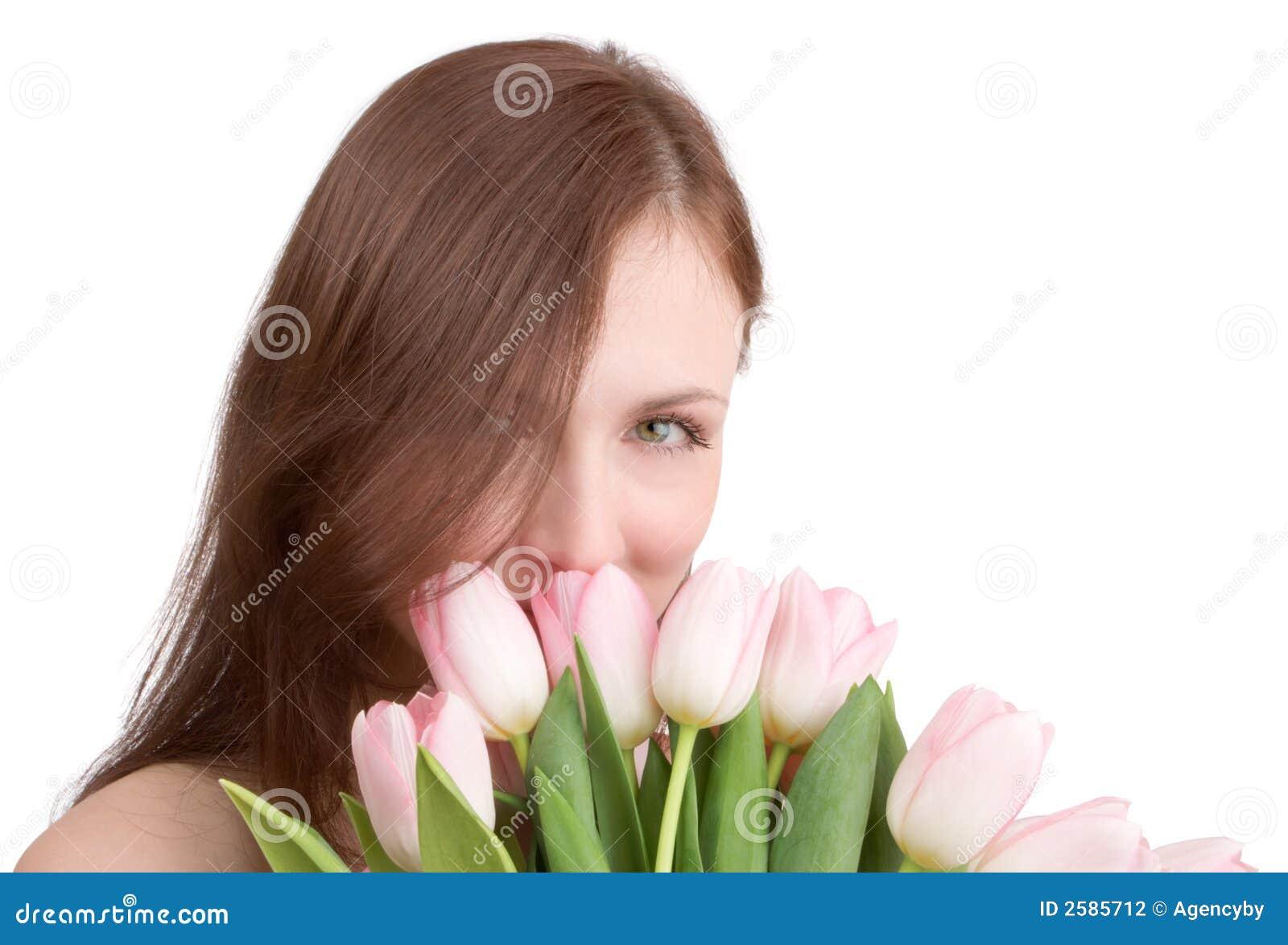 Het portret van de vrouw met tulpen