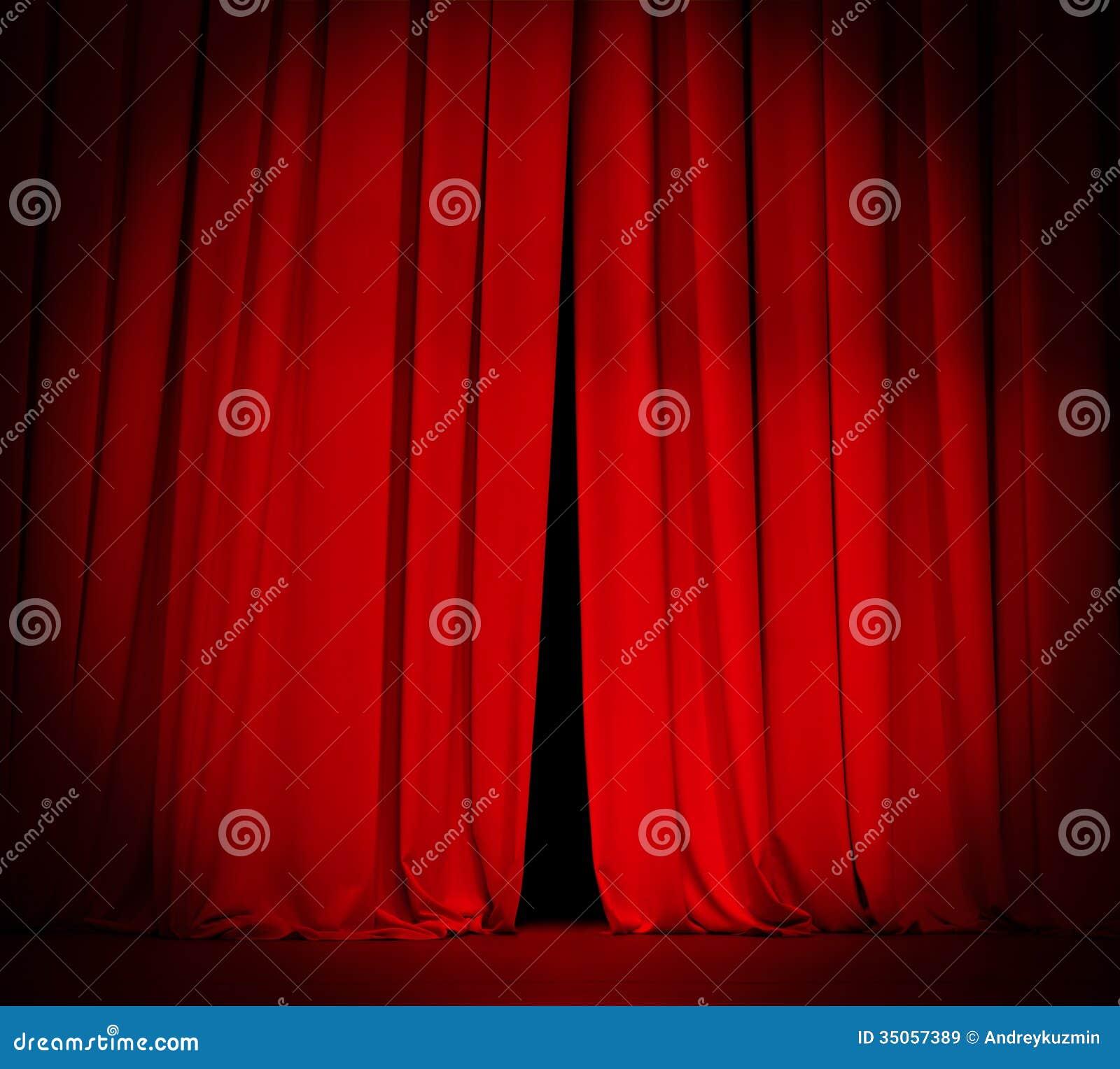 Het rode gordijn van het theaterstadium met schijnwerperachtergrond