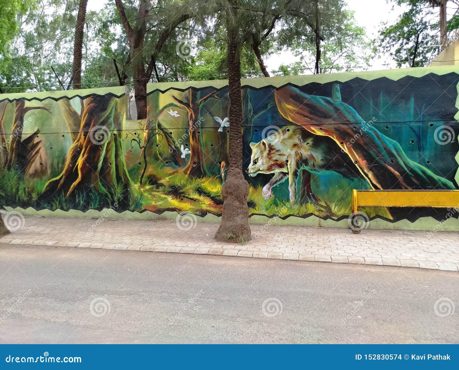 Het schilderen op muur door een lokale kunstenaar