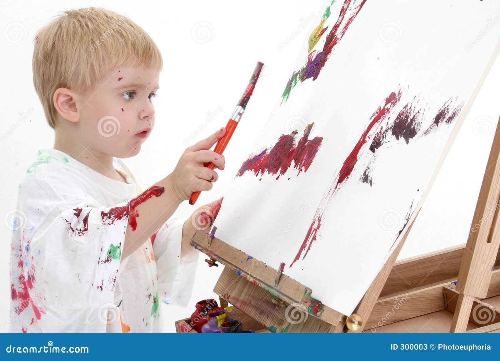 Het schilderen van de jongen van de peuter van addorable bij schildersezel stock afbeelding - Schilderen kind jongen ...