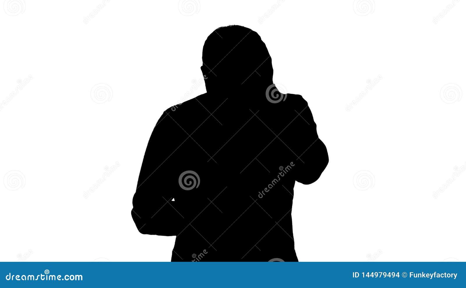 Het silhouet beklemtoonde de jonge mens verrast schokte, met afschuw vervulde en, stoorde door wat hij op zijn celtelefoon ziet