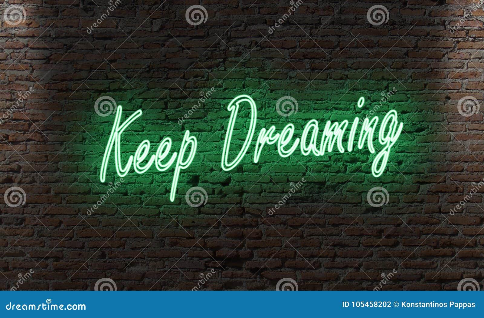 Het teken van de neonbrief met het citaat houdt binnen dromend op een bakstenen muur