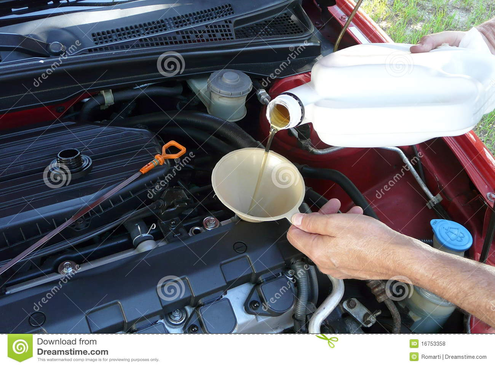 Het toevoegen van de Olie van de Motor aan Auto