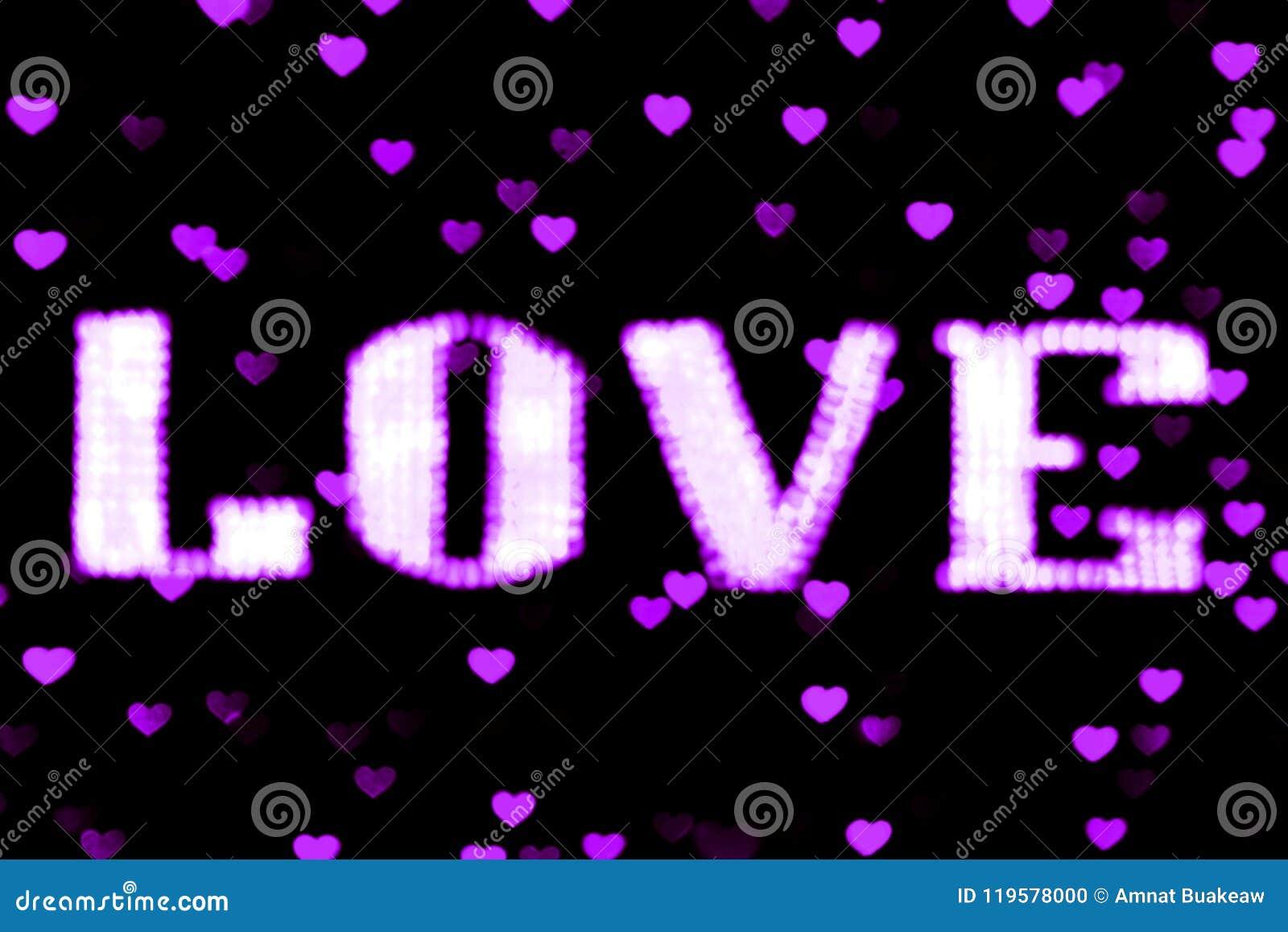 Het vage het teken LEIDENE van de tekst purpere LIEFDE neon van Bokeh lichtpaars op zachte kleurrijk van het achtergrond bokeh li