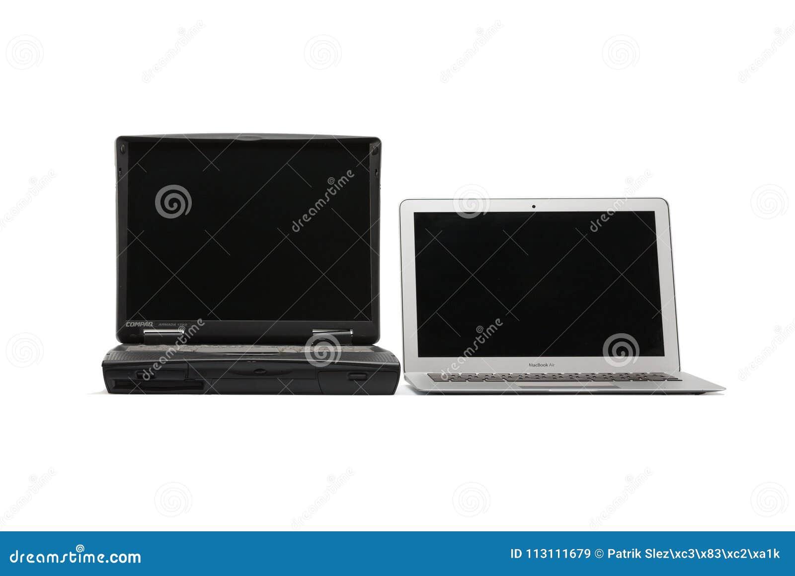 Het vergelijken van laptops, nieuwe moderne en oude laptop