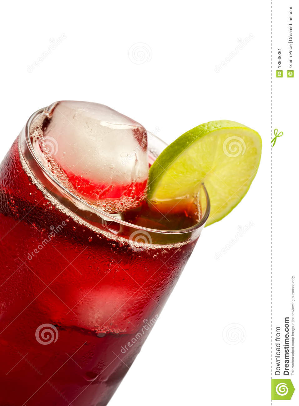 ... glass of iced hibiscus tea with slices of lime on white background