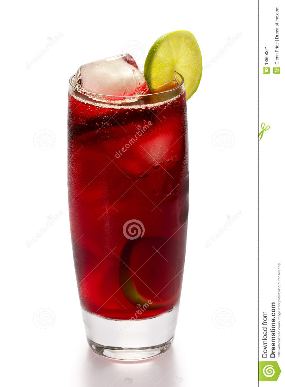 glass of iced hibiscus tea with slices of lime on white background.