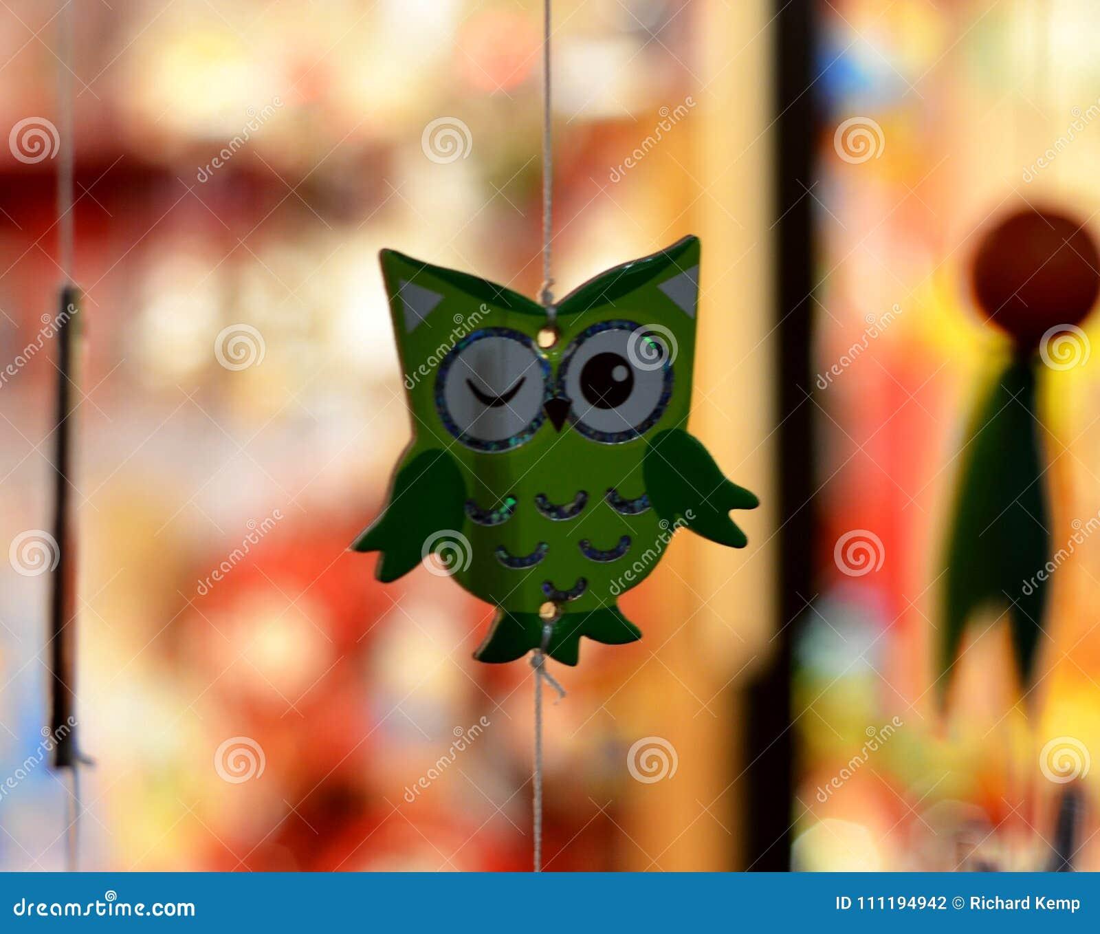 Hibou clignotant vert