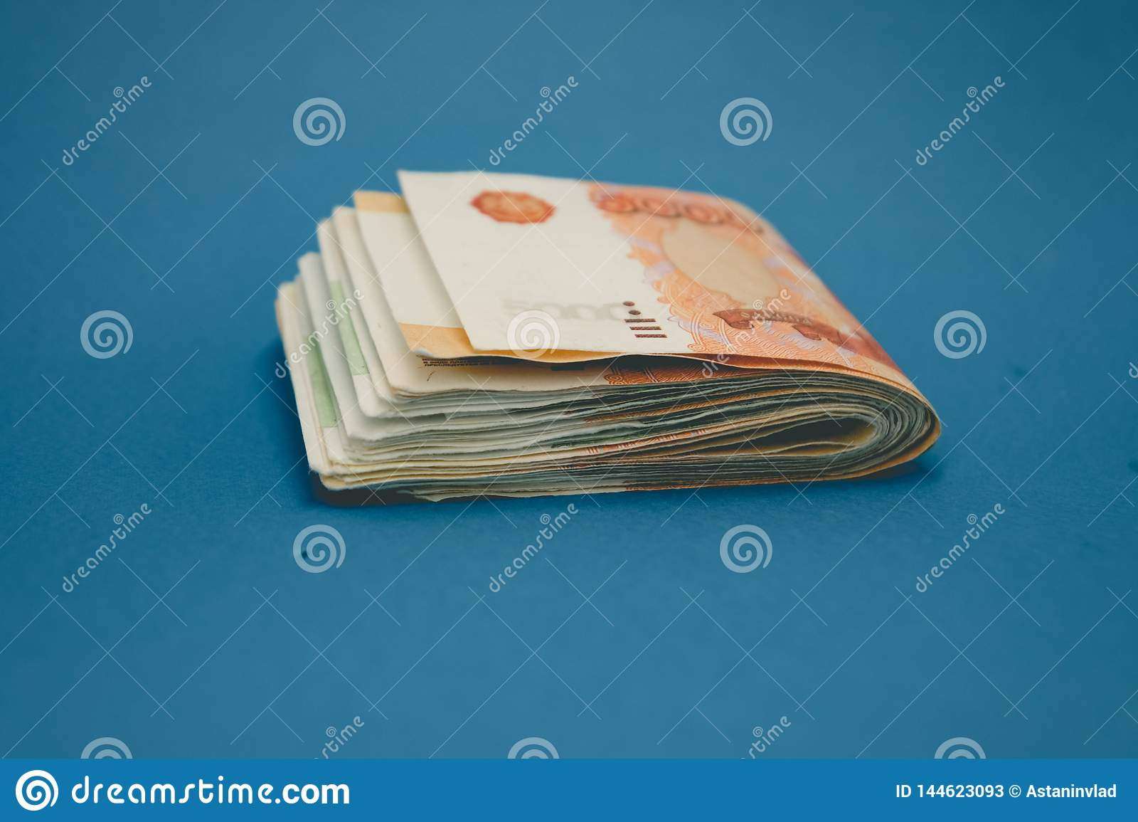 hick stack of cash money. The concept of rich, wealth, profits, business and finance. Five thousandth bills banknotes