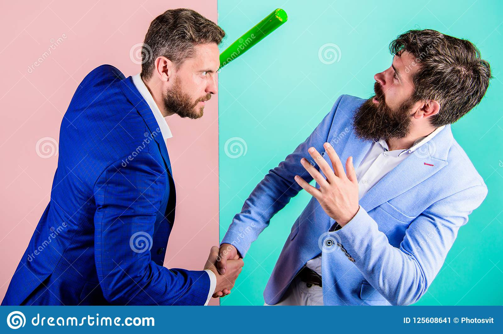 Hidden threat concept. Business partners competitors office colleagues shaking hands. Tricky first impression. Dangerous