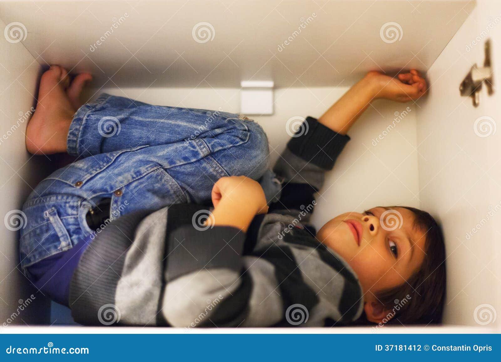 Child hiding in a clos...