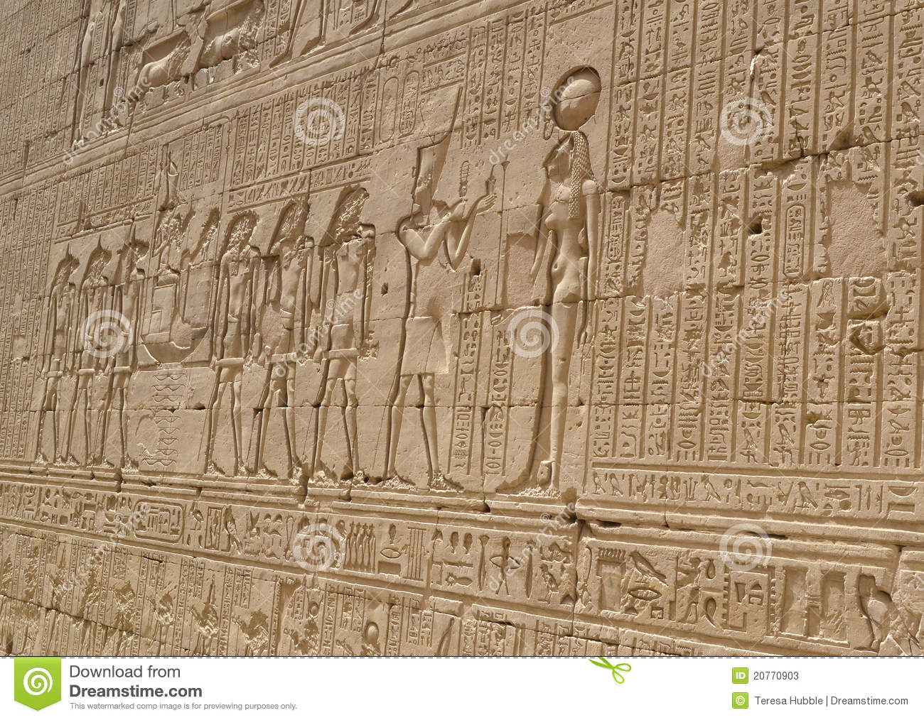 Hieroglyphic carvings in an egyptian temple wall stock