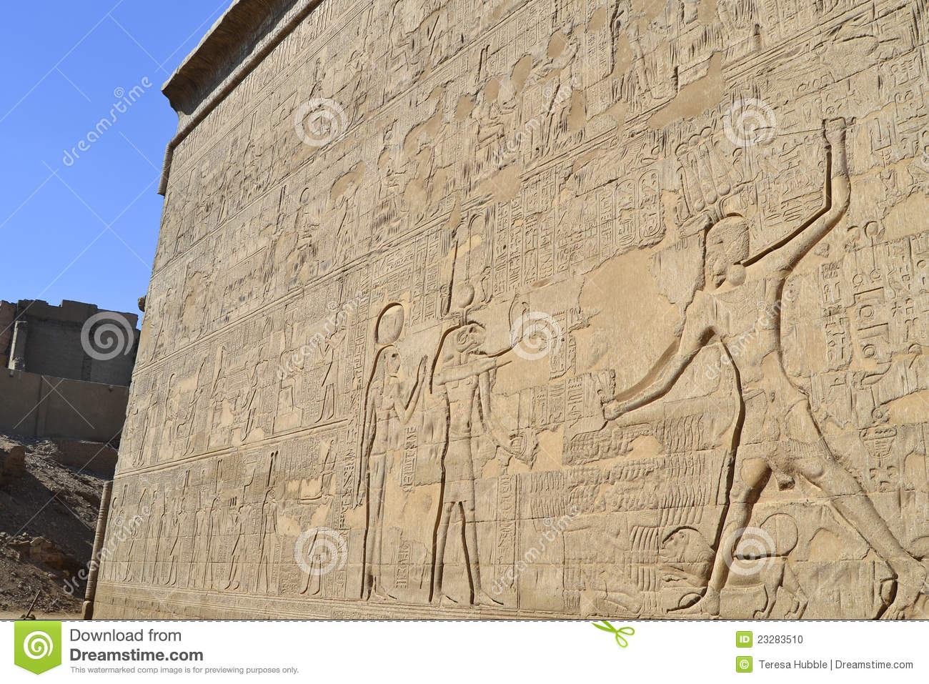 Hieroglyphic carvings on an egyptian temple wall stock