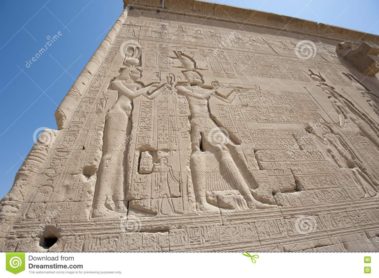 Hieroglypic carvings on an egyptian temple royalty free
