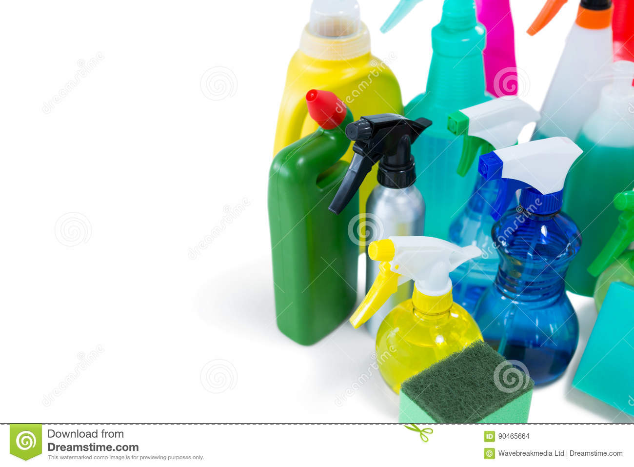 High angel view of colorful spray bottles with sponges and gloves