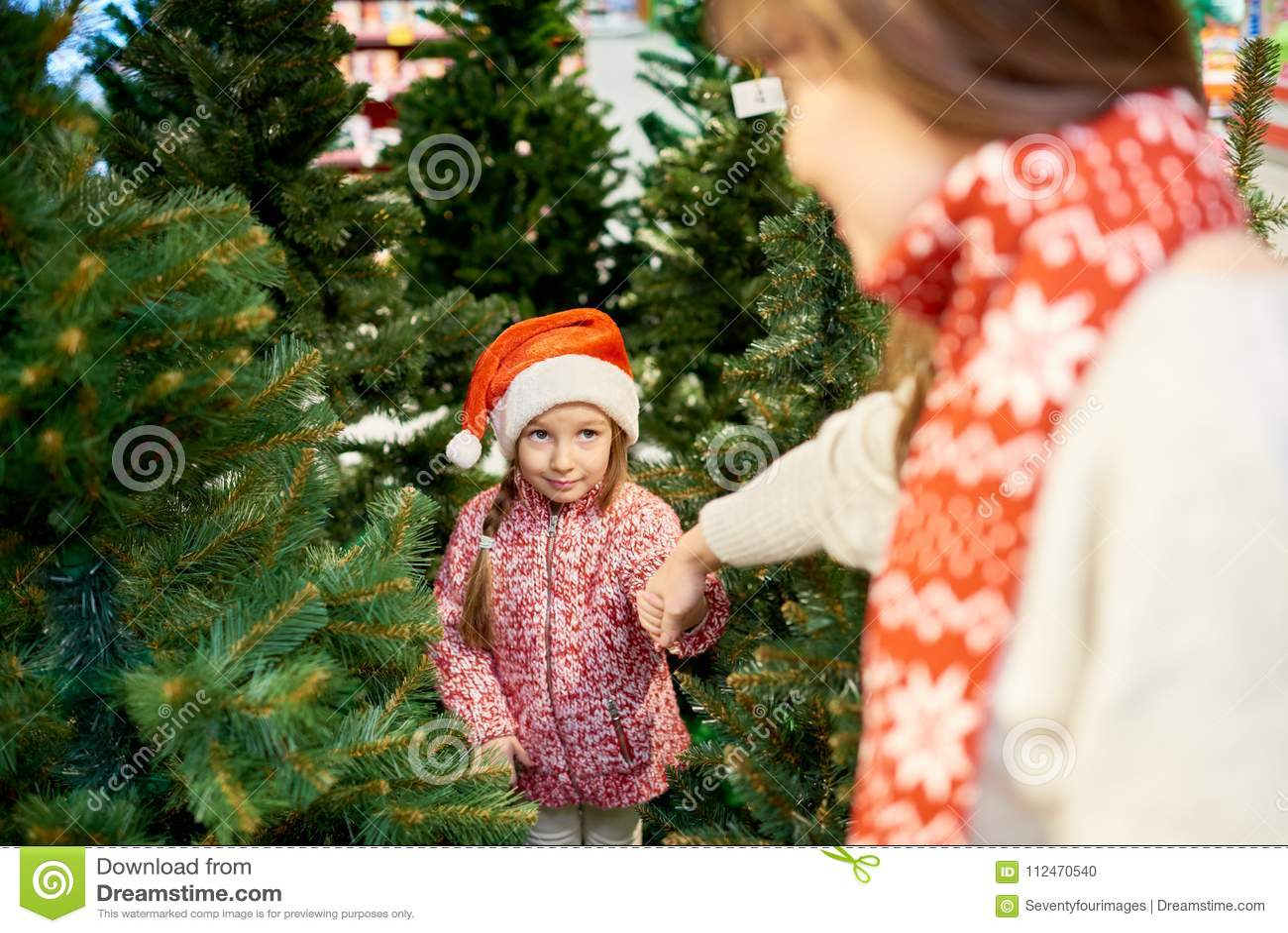 Little Girl Choosing Christmas Tree Stock Photo
