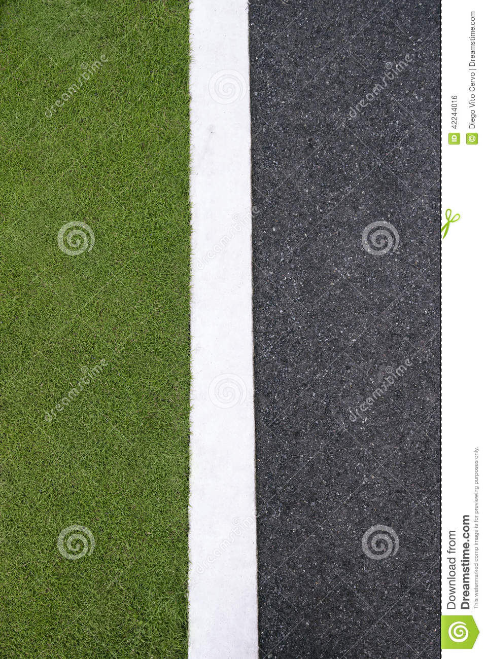 High angle view of asphalt of street and grass