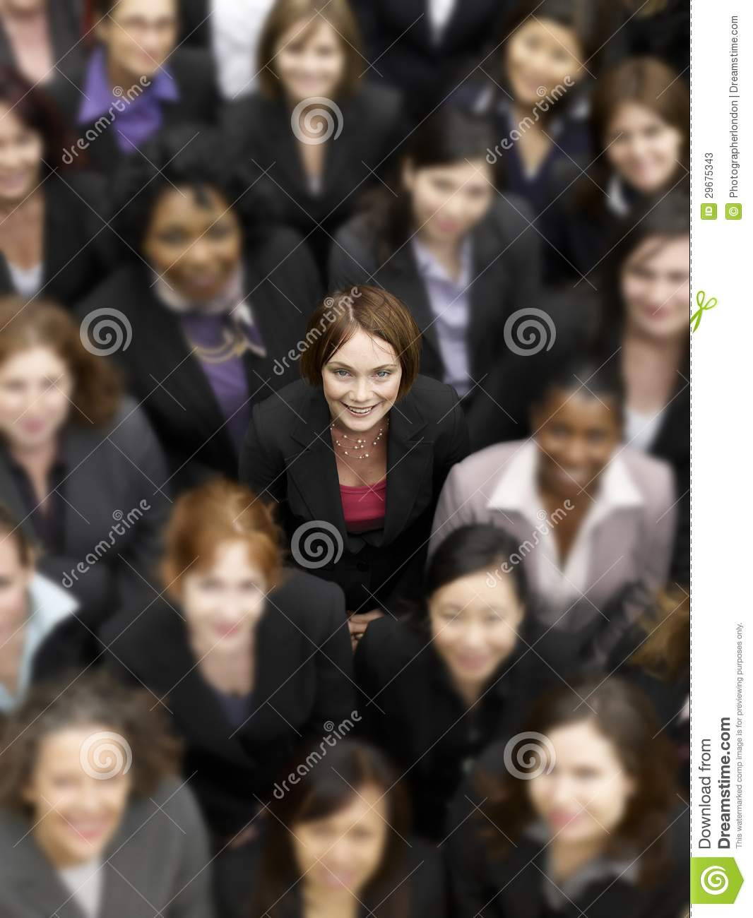 High angle view of a businesswoman standing amidst multiethnic businesspeople