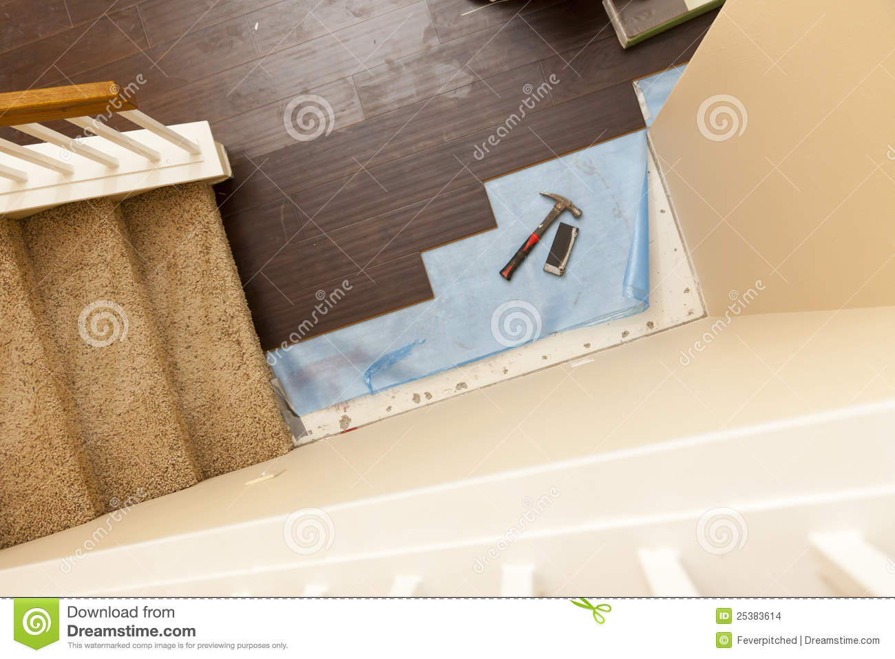 High Angle View of Hammer and Block with New Laminate Flooring