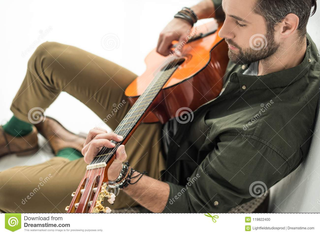 high angle view of handsome musician playing