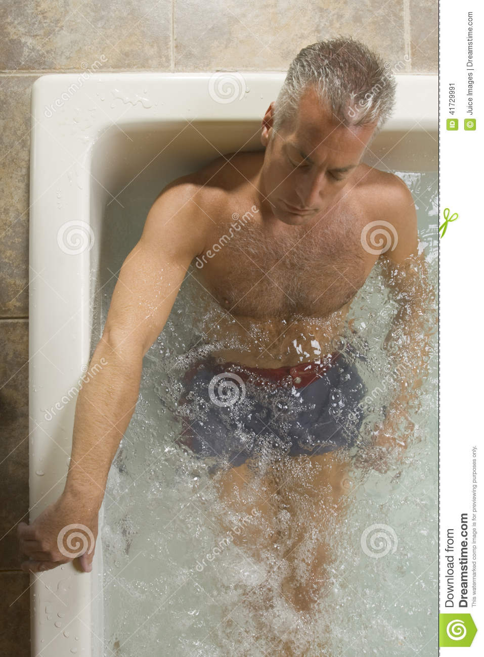 High angle view of a mature man in a jacuzzi