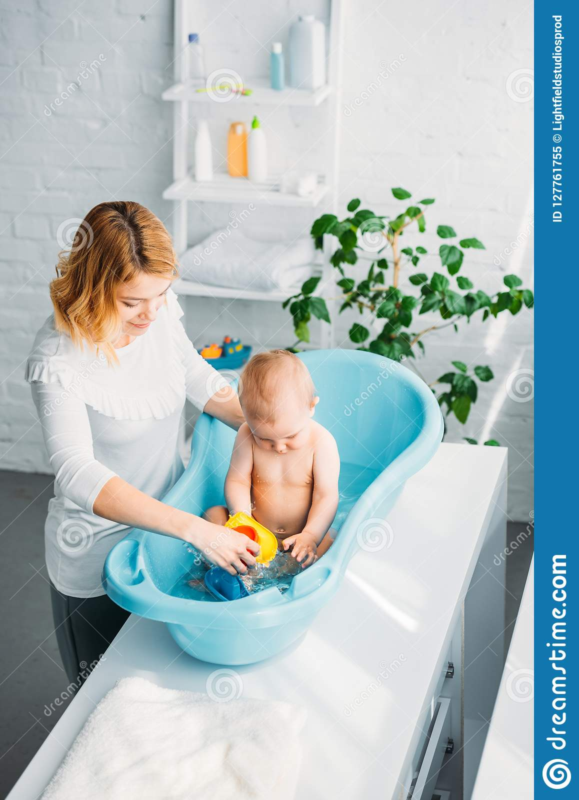high angle view of mother washing her little child