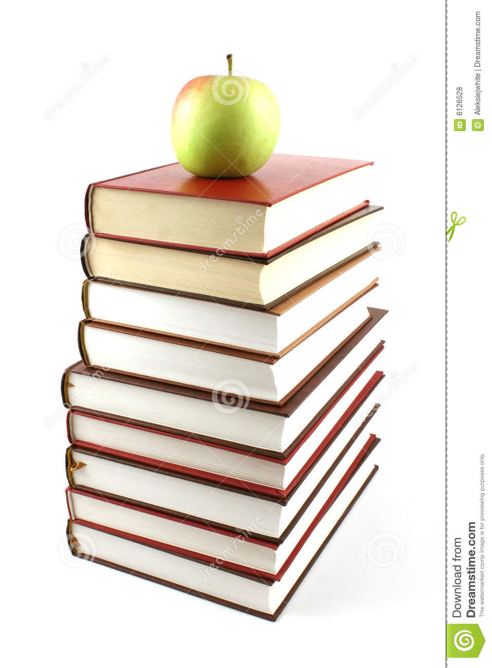 High books pyramid with green apple on top