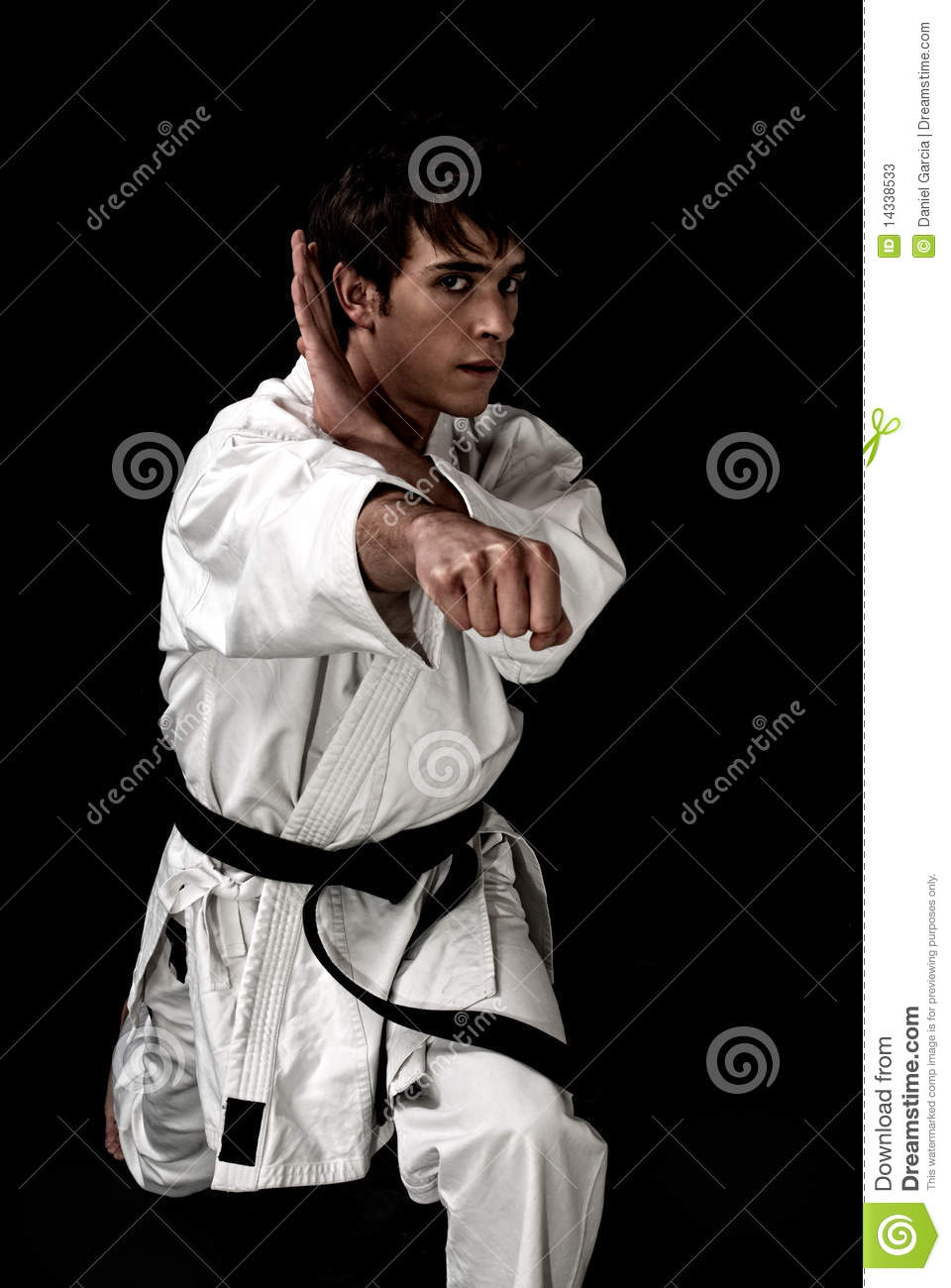 High Contrast karate young male fighter on black