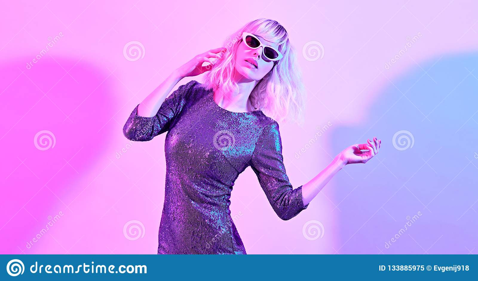 a996de1f Glamour Disco Girl with Blonde Hair dance in Trendy Sequin Dress,  Sunglasses. Creative woman Portrait. Contemporary style