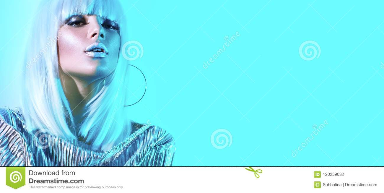 High fashion model girl in colorful bright neon lights posing in studio. Portrait of beautiful woman in white wig