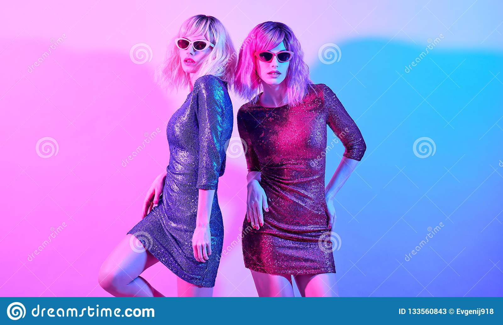 206fc344 High Fashion Model in Trendy Sequin Dress dance in colorful bright neon  pink and purple lights. Disco girl with Dyed Hair. Adorable women in Party  Luxury ...