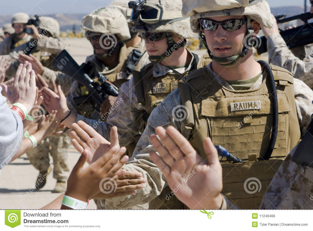 High-fives from soldiers