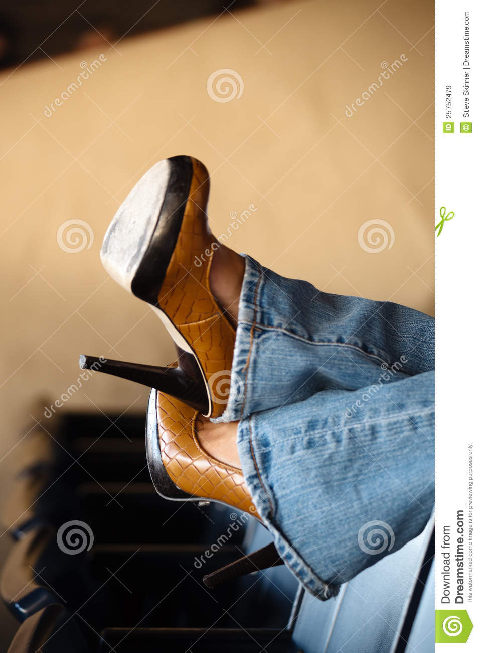 High heels and blue jeans stock image. Image of shoe - 25752479