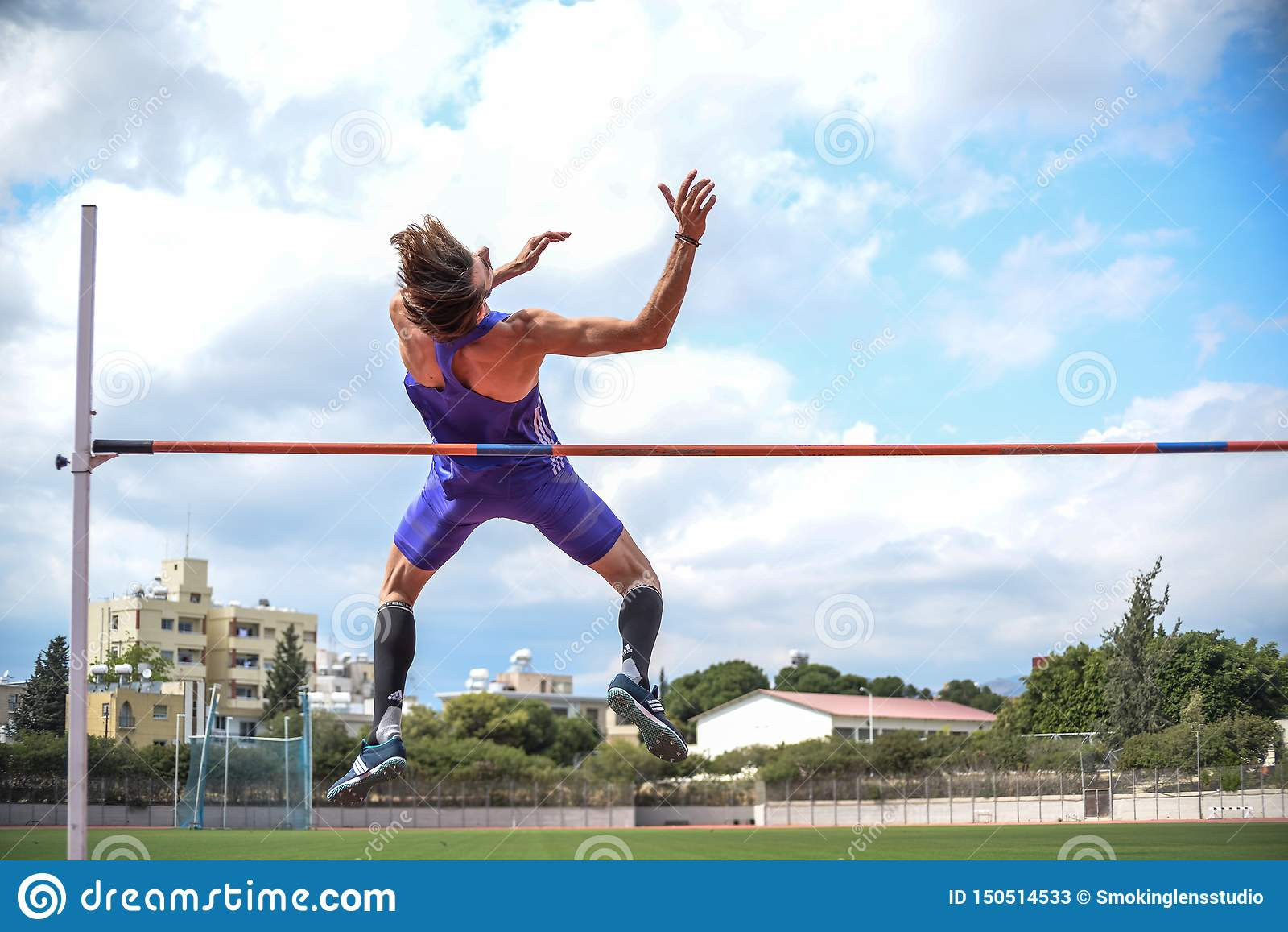 High jump athlete while he jumps. Closeup