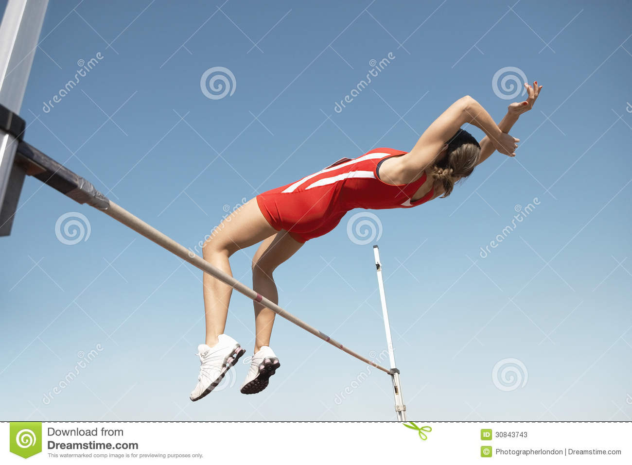 High Jumper In Midair Over Bar
