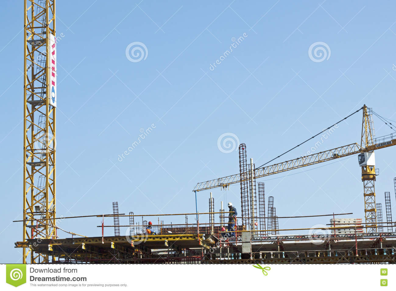 High lift Crane and Workers Woking on Construction Site