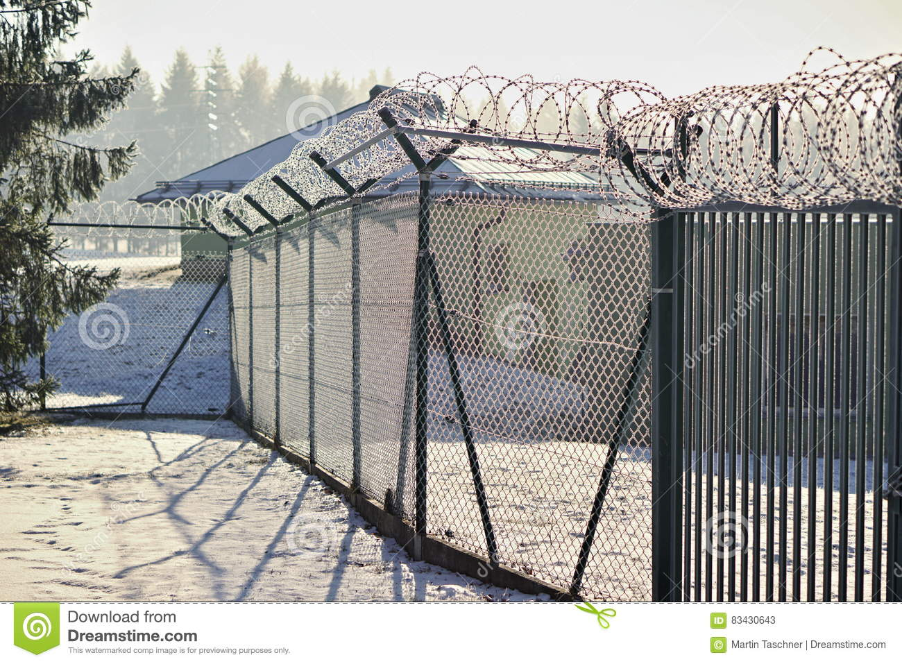 High Metal Fence With A Sharp Barbed Wire On The Top Covered By Snow ...