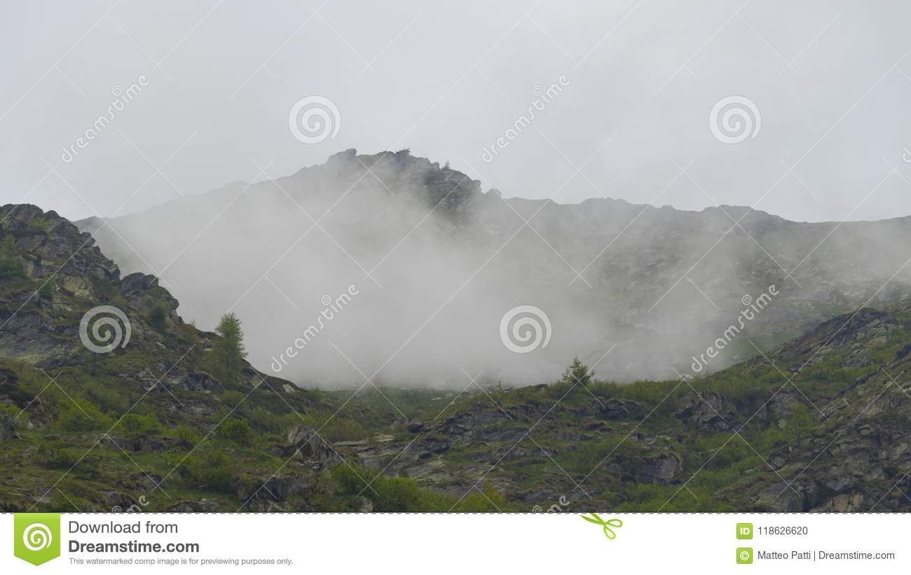 High mountain surrounded by myst