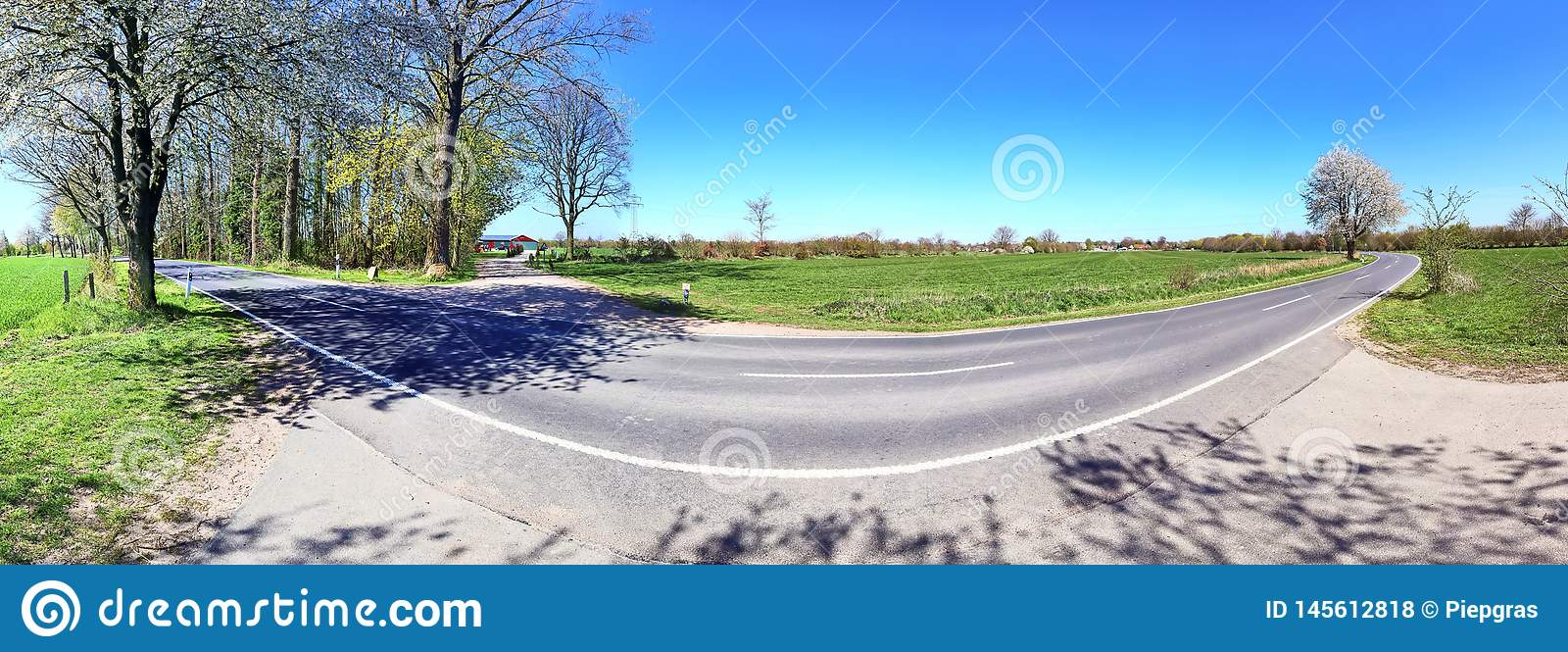 High resolution panorama view on green landscapes with a blue sky found in northern germany