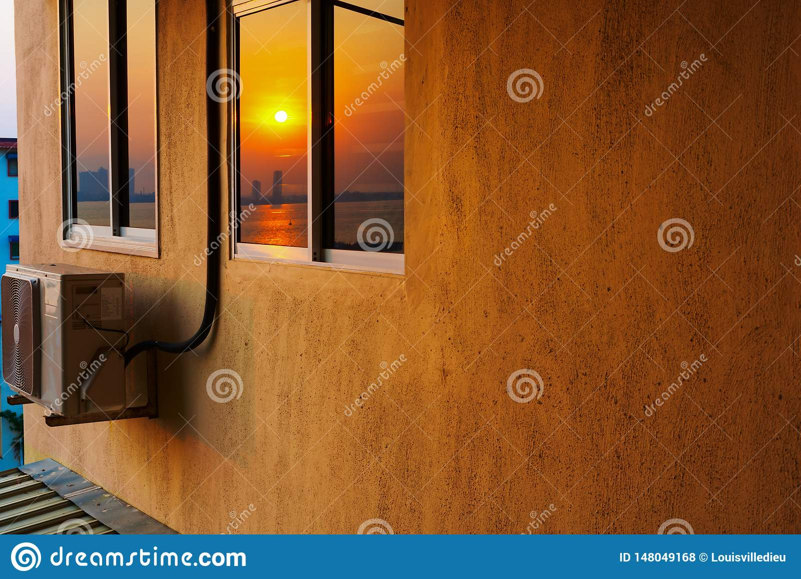 High-rise housing with air conditioning at the sunrise