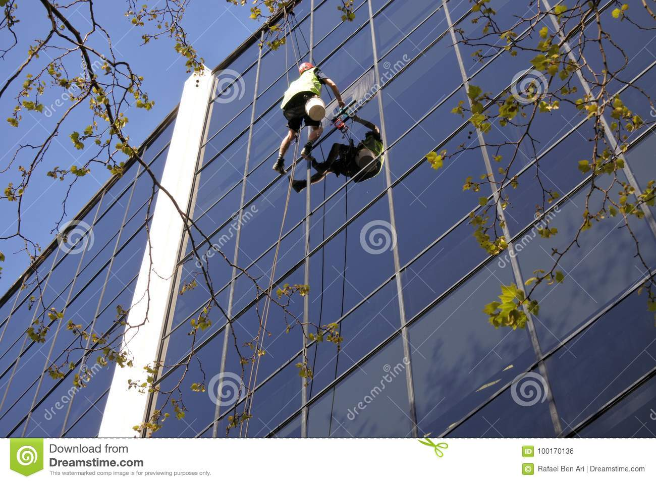 High rise window cleaning worker cleans an office building