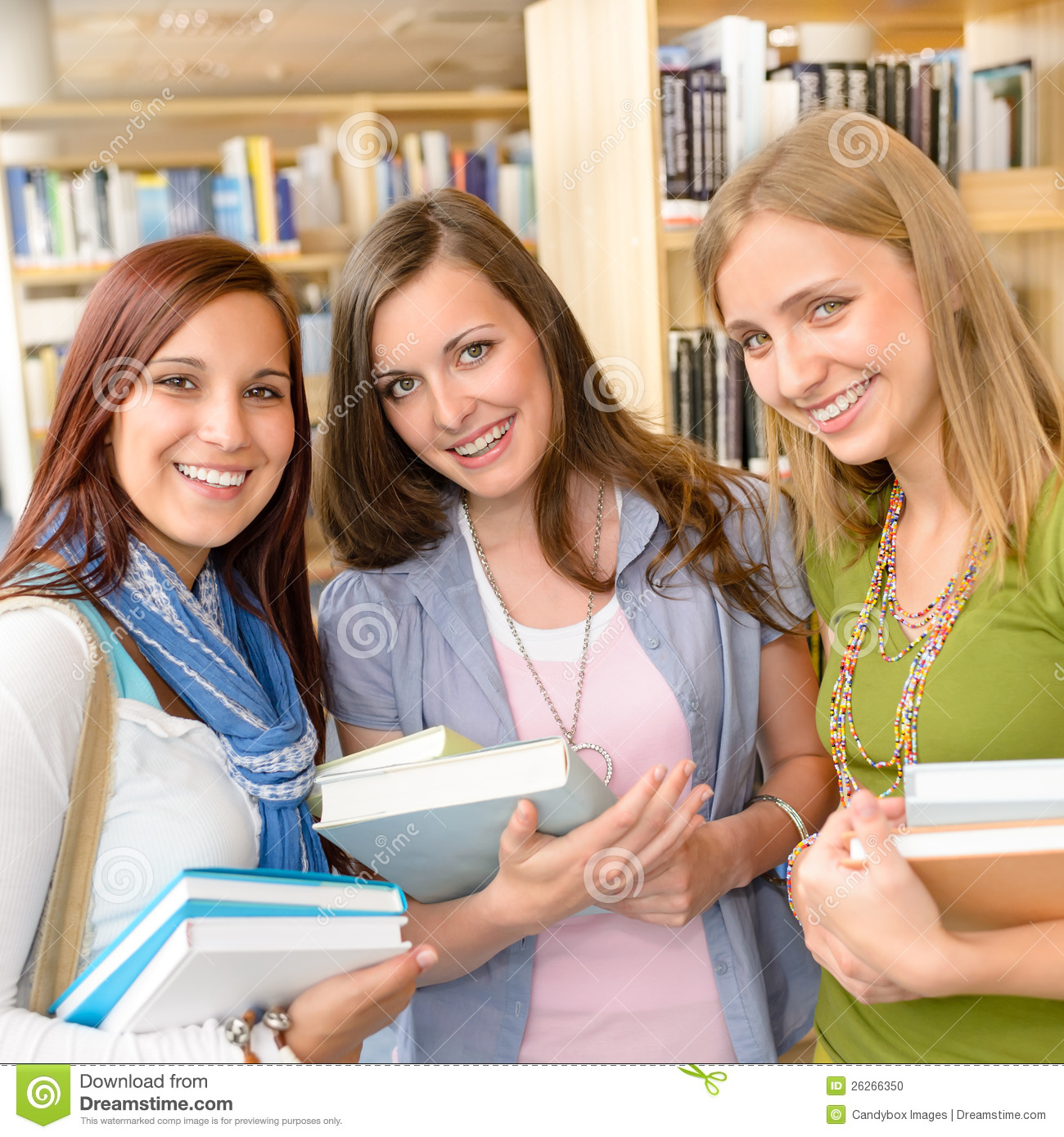 high school classmates with library books stock photo image
