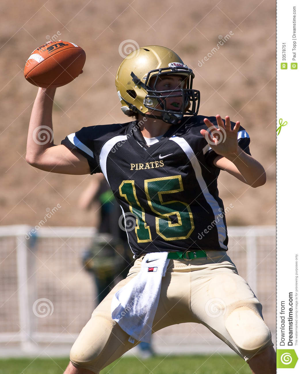 football player from Harbor High School in California, throws a pass ...