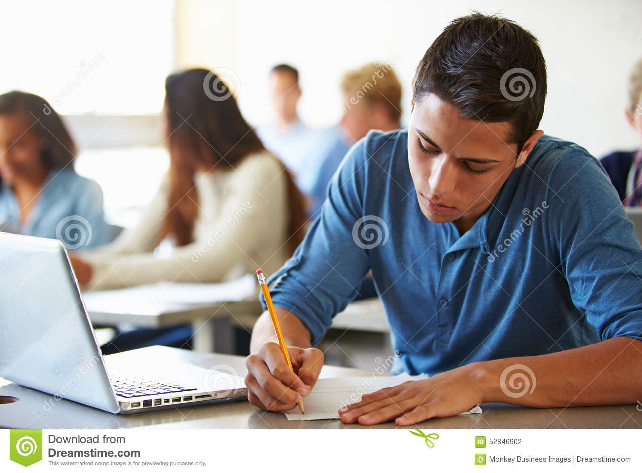 high school students taking test in classroom stock photo